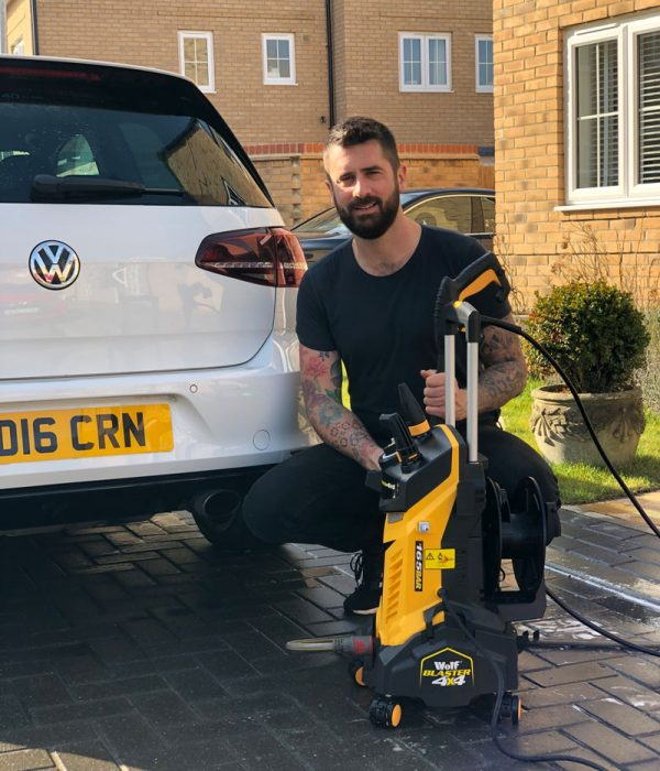 Michael Perry with the Wolf Blaster 4x4 pressure washer
